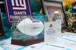 Items for auction including New York Giants football and Star Wars memorabilia