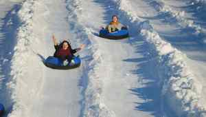Girls ride from a snowy mountain Girls ride from a snowy mountain