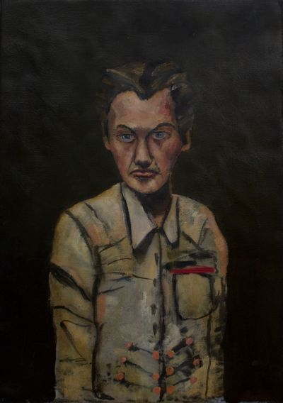 Man in Tan Shirt with Striped Pocket