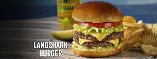 Hamburger and potato chips with text Landshark Burger